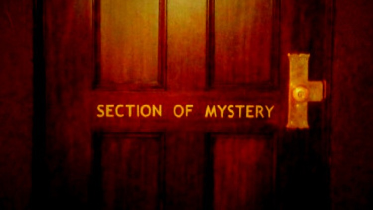 "Door that says ""Section of Mystery"" on it"
