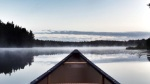 Prow of a canoe on a lake