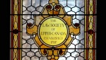 Stained glass window with text Law Society of Upper Canada established 1797