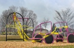 Playground during the pandemic with caution tape draped over it